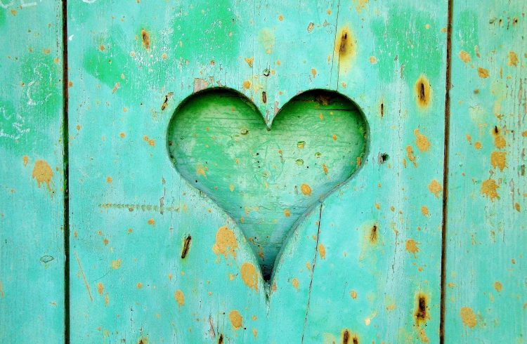 Heart Cut Out on a Turquoise Green and worn Wooden Door