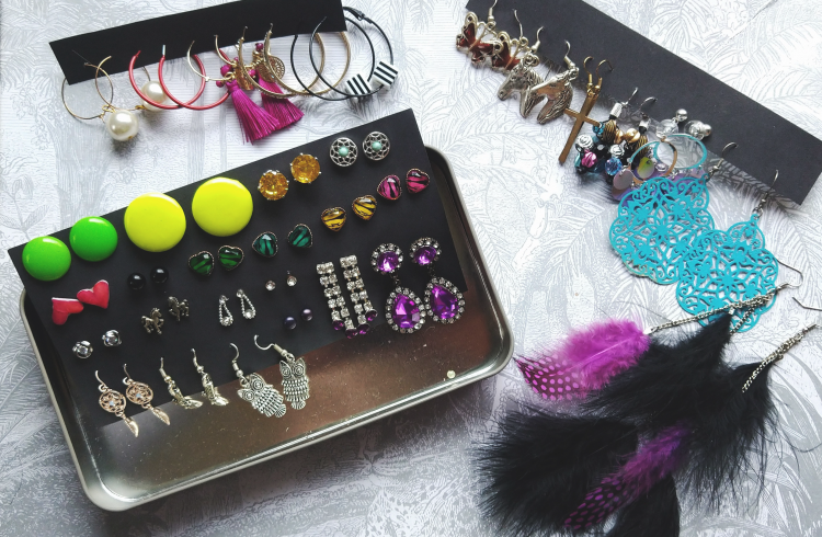 Organised Jewelery on Black Paper Boards and in a Silver Honey Jewelry Box