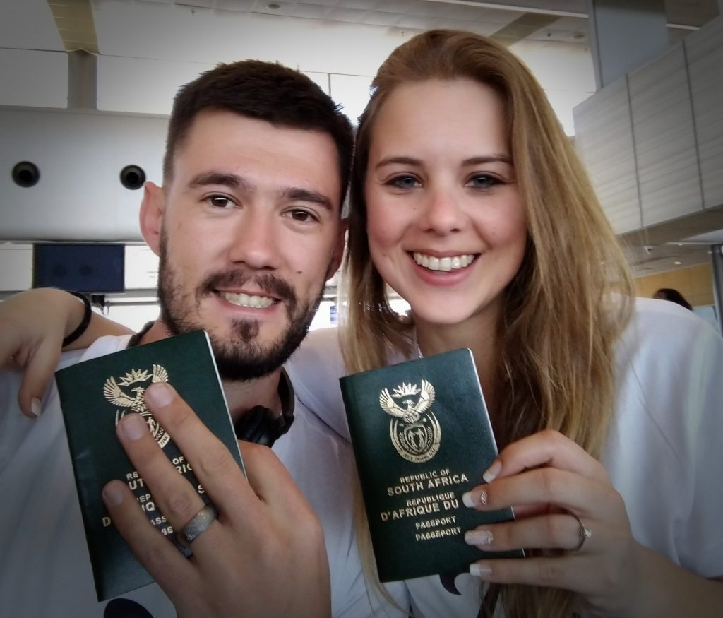 Husband-and-wife-holding-south-african-passports-on-honeymoon-to-Bali