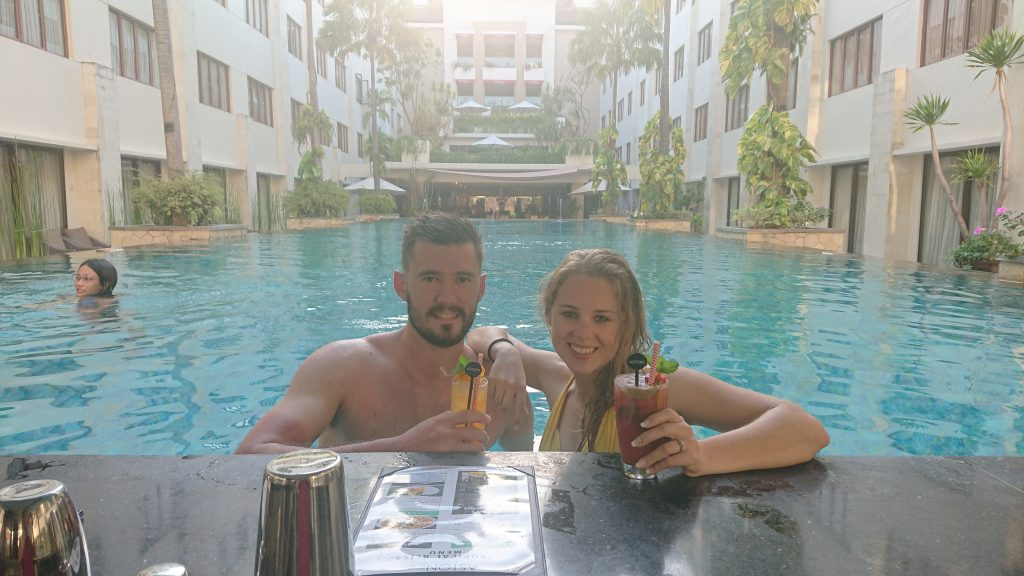 husband-and-wife-sipping-cocktails-at-a-hotel-pool-at-aston-kuta-hotel-september-2019