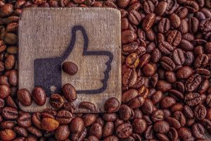 Blue Facebook Like on Light Wood in Brown Coffee Grounds