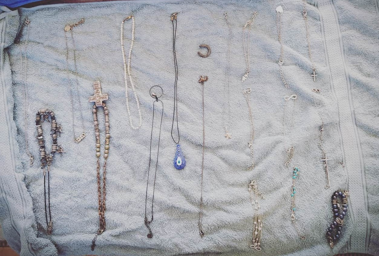Silver Jewelry Neatly Placed on Light Green Towel