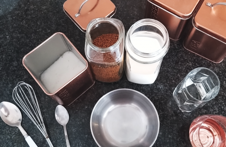 Dalgona Coffee Flat Lay Ingredients and Utensils on Black Kitchen Counter